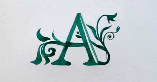 This example of a vintage-style letter incorporates intricate, botanical-inspired details.
