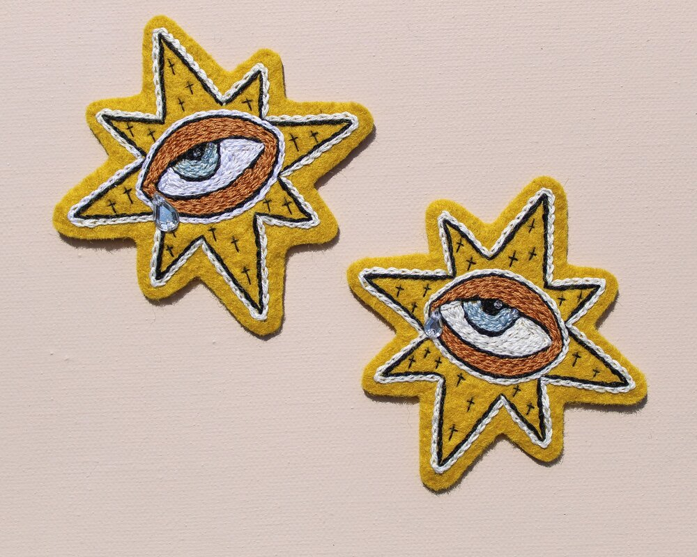 """""""Weepy Starry Eye"""" hand embroidered patches by Carly Owens"""