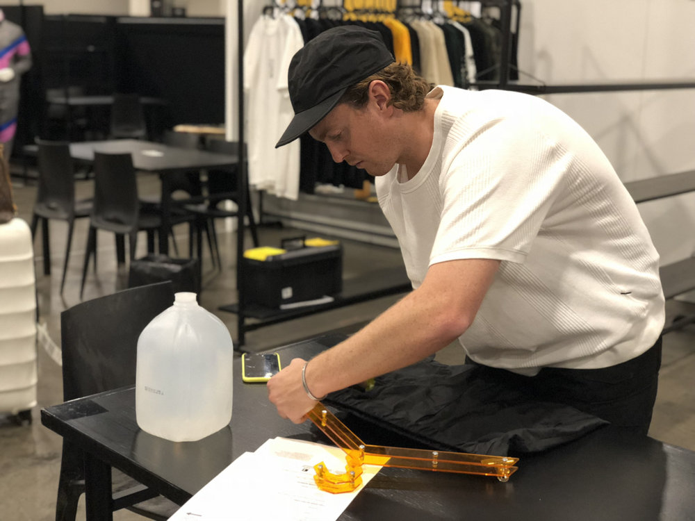 Workshop student Ed Cunningham hangs items for his brand,  DAYSWORK , a line that he says is inspired by the innovation, quality, and authenticity of the industrial working class of the 1900s.