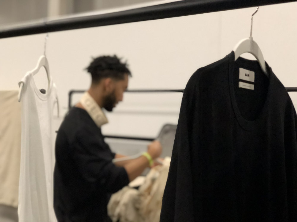"""Workshop participant Brennan Manuel works on the display for  6AM , a brand he says was created """"for those who rise early and work late fulfilling their purpose."""""""