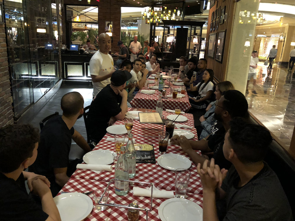 Legendary designer and Build Your Brand Workshop teacher Jeff Staple shares a toast with the workshop finalists at a dinner in their honor.
