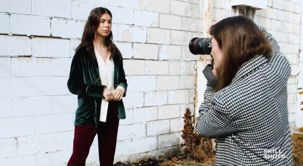 Skillshare instructor and photographer Jessica Kobeissi takes a photo of a model during a photo shoot.