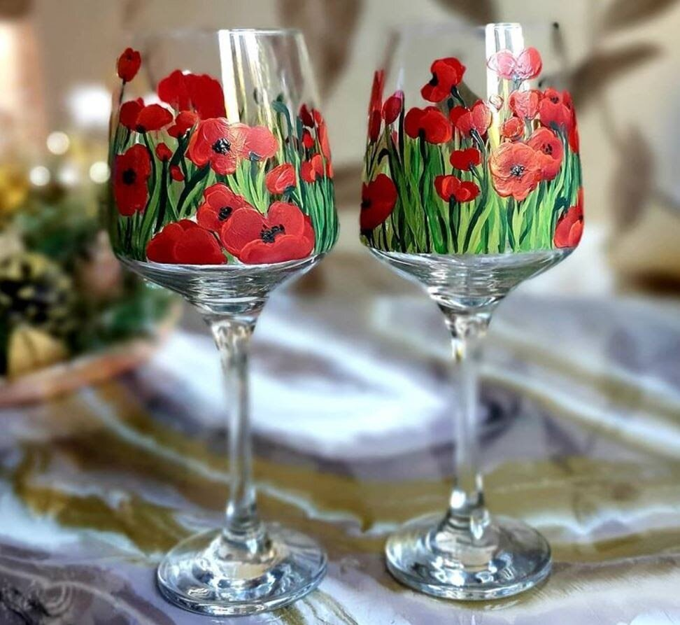 Simple wine glasses get a whole new look with a painted floral landscape.