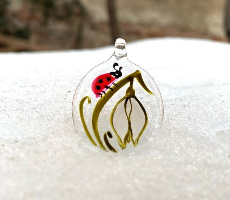 Paint designs on glass pendants and then string onto wire for easy homemade jewelry.