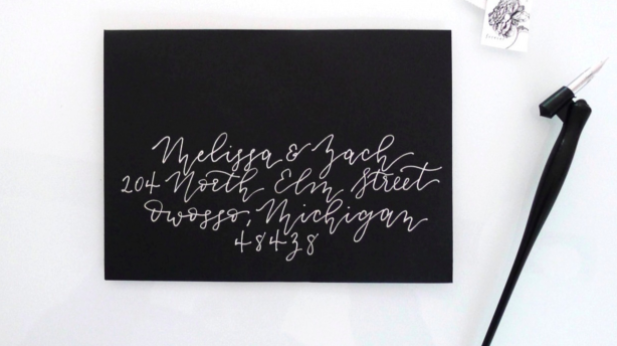 This monoline calligraphy, done in white ink on a black envelope, gives this project a modern look.