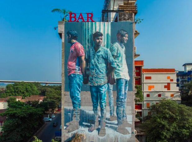 """""""Four men holding Roman column,"""" by Fintan Magee for St+art India in Goa, India"""