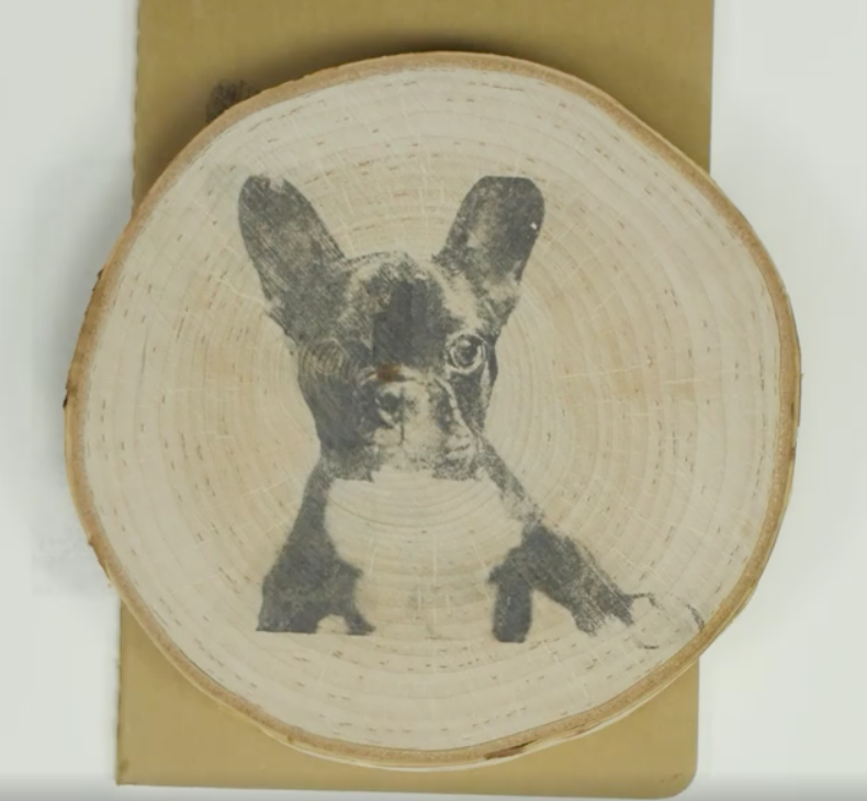 Photo transfers can be done on any dry surface, like a piece of wood shown here.