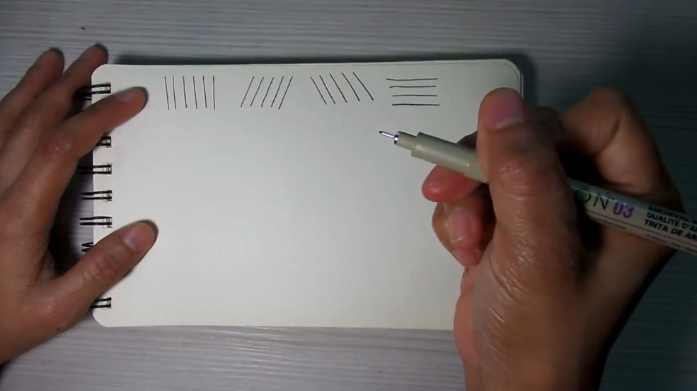 Skillshare instructor Madonna Creates demonstrates the different types of straight lines that you can draw as you begin to learn line art techniques.