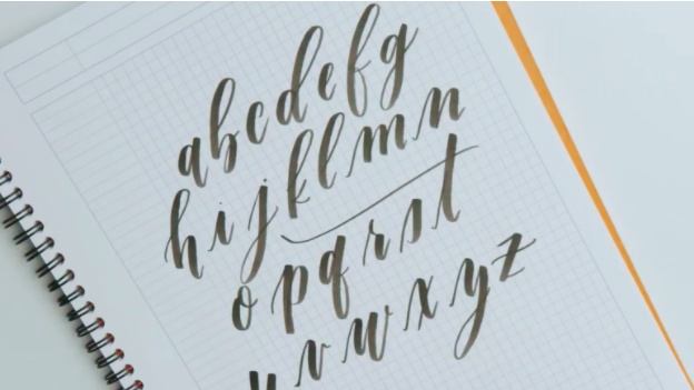 Brush lettering relies on a flexible felt-tipped marker or paint brush, which responds to varying levels of pressure to create thick and thin lines.