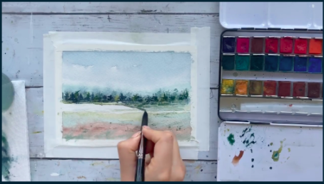After allowing the first layer of paint to dry, the artist goes back to her illustration to add darker colors and finer details.