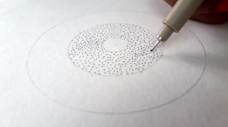 Adding dots, known as stippling, gives your sunflower a realistic look.