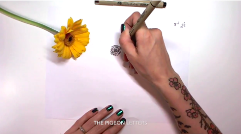 Having a photo or the flower next to you can help make sure your drawing is realistic, as Skillshare teacher Peggy Dean demonstrates.