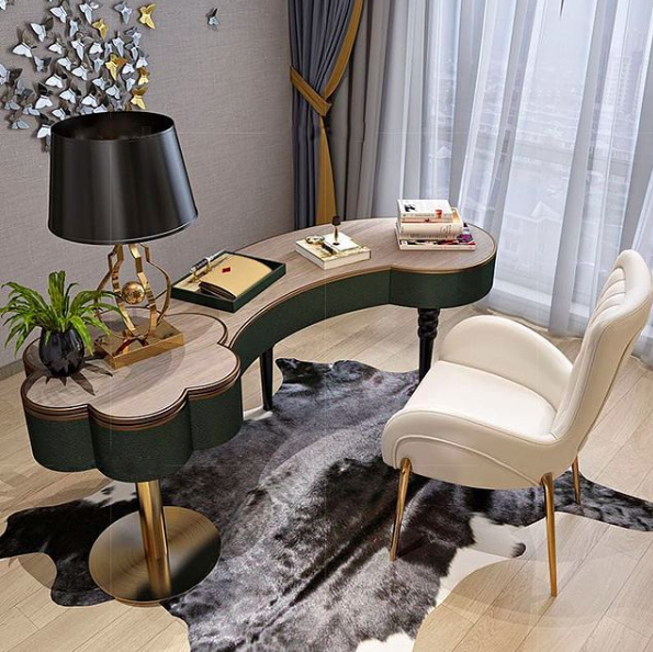 Source:    Instagram     Area rugs are a nice addition to a home office.