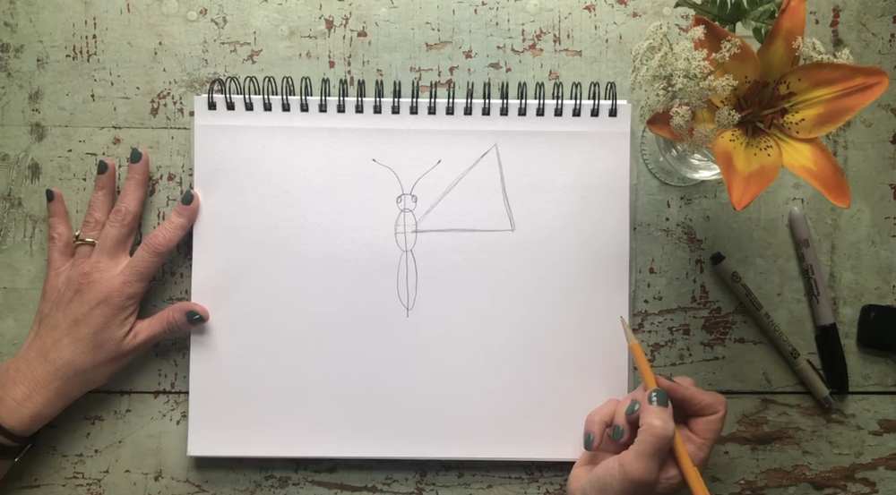 Use the marks from before to draw a triangle for the top wing.