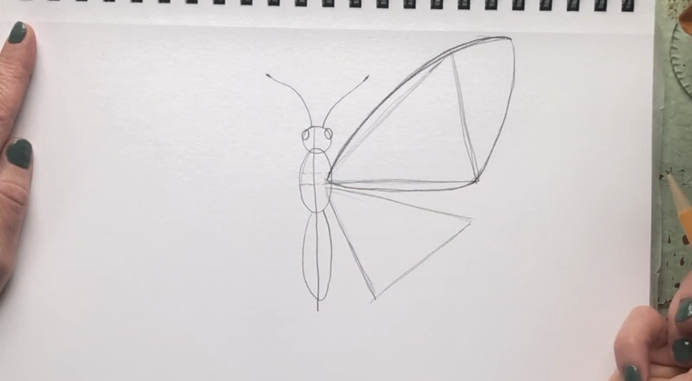 Start the wing outline by drawing a curved line above the top triangle.