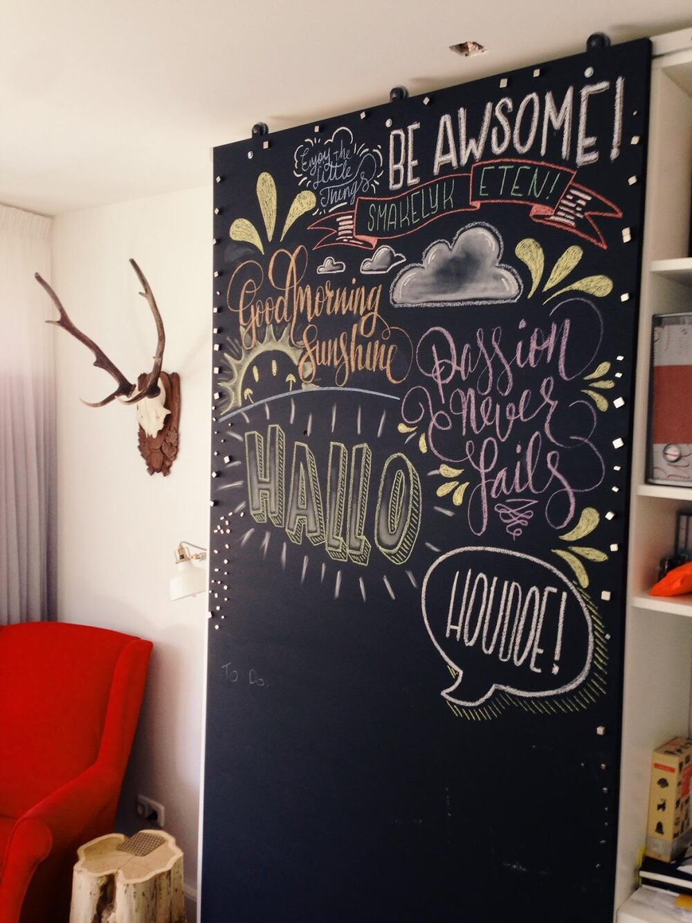 Chalkboard paint is fun  and  functional for a home office, as this mural by visual designer John Somers shows.