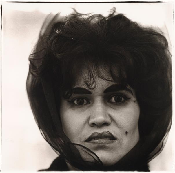 A neutral background can showcase a subject's individuality.   Puerto Rican Woman with a Beauty Mark,  Diane Arbus, 1969 ( image source )
