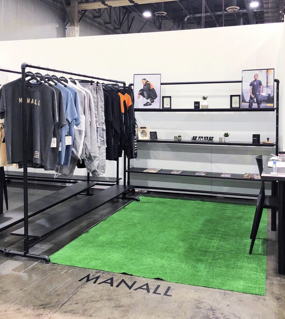 The M A N A L L booth