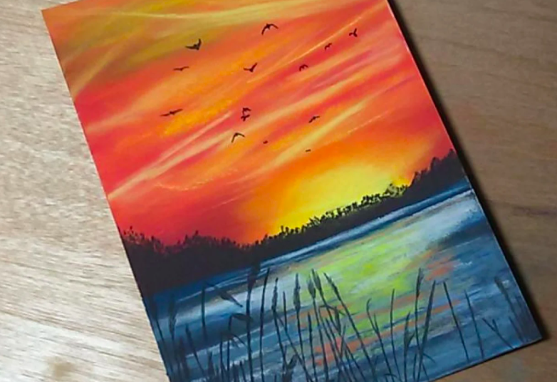 A simple, yet beautiful pastel sunset over the lake by Skillshare student Annette Zimmerman.