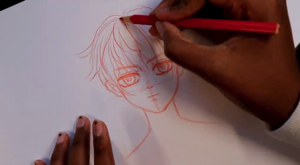 Hair being added in pencil to a male anime drawing.