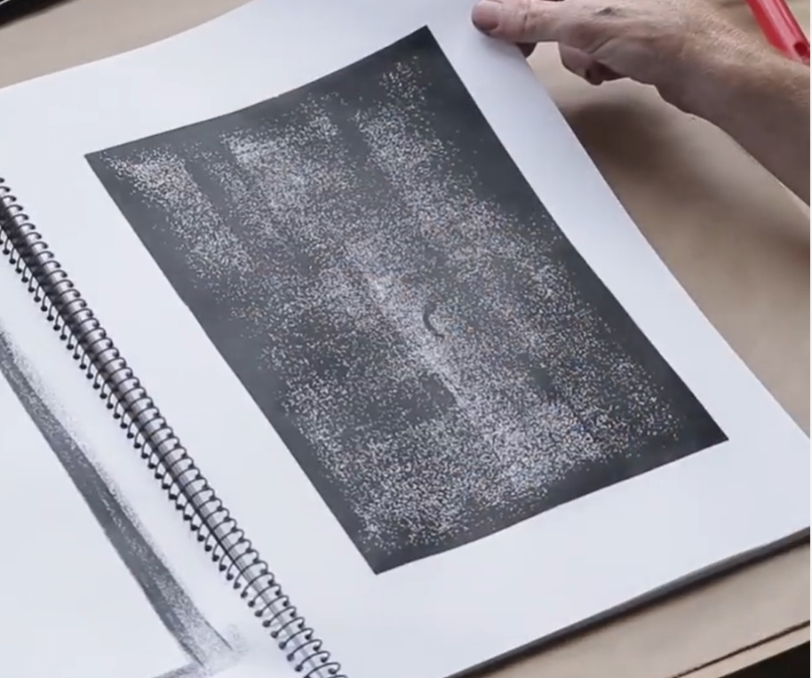 Use a paint roller on paper to create a dappled texture.