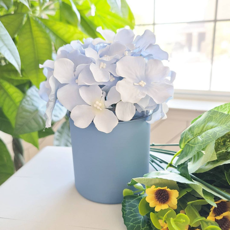 Source: Instagram  @longlegacypaint   A couple coats of paint turned a plastic gelato container into a pretty vase.