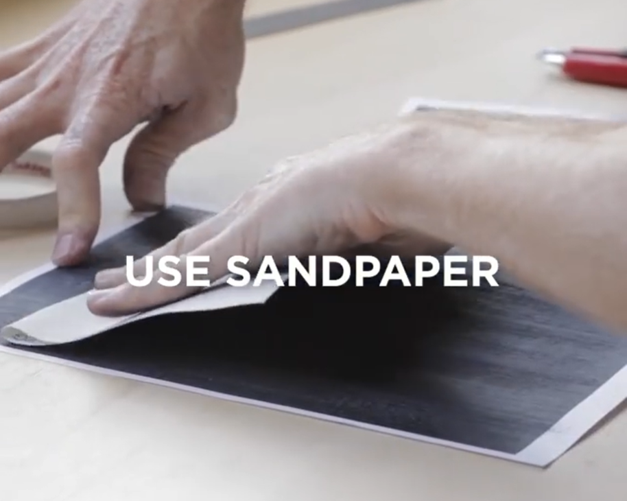 Scratch the surface of paper with sandpaper or a brick wall.