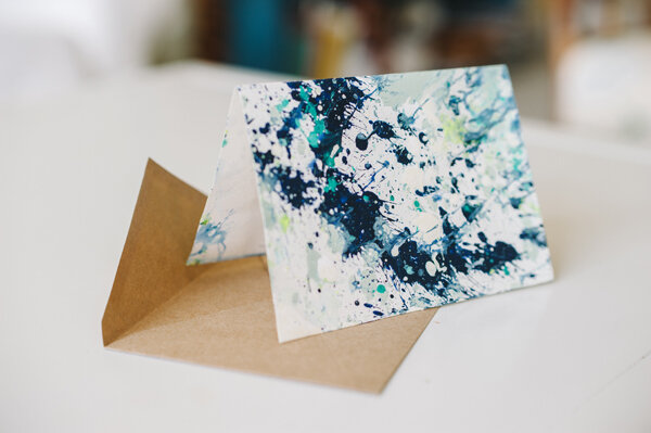 Stamp a monogram on paint splatter note cards, like these created by    Rebekah J. Murray   .