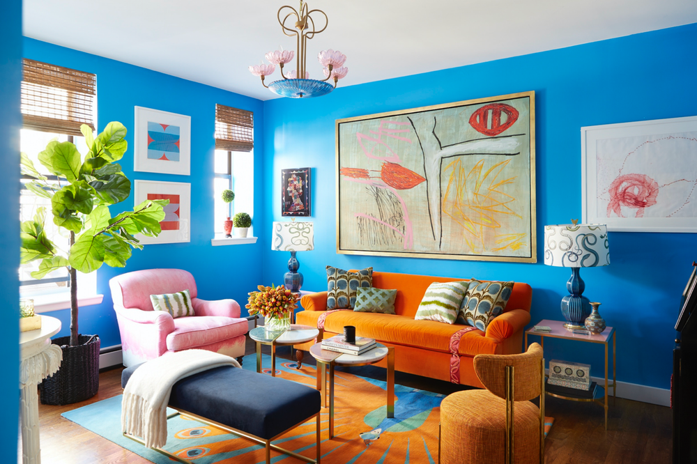 Interior designer Courtney McLeod blends unique artwork and multi-colored furniture in this living space.