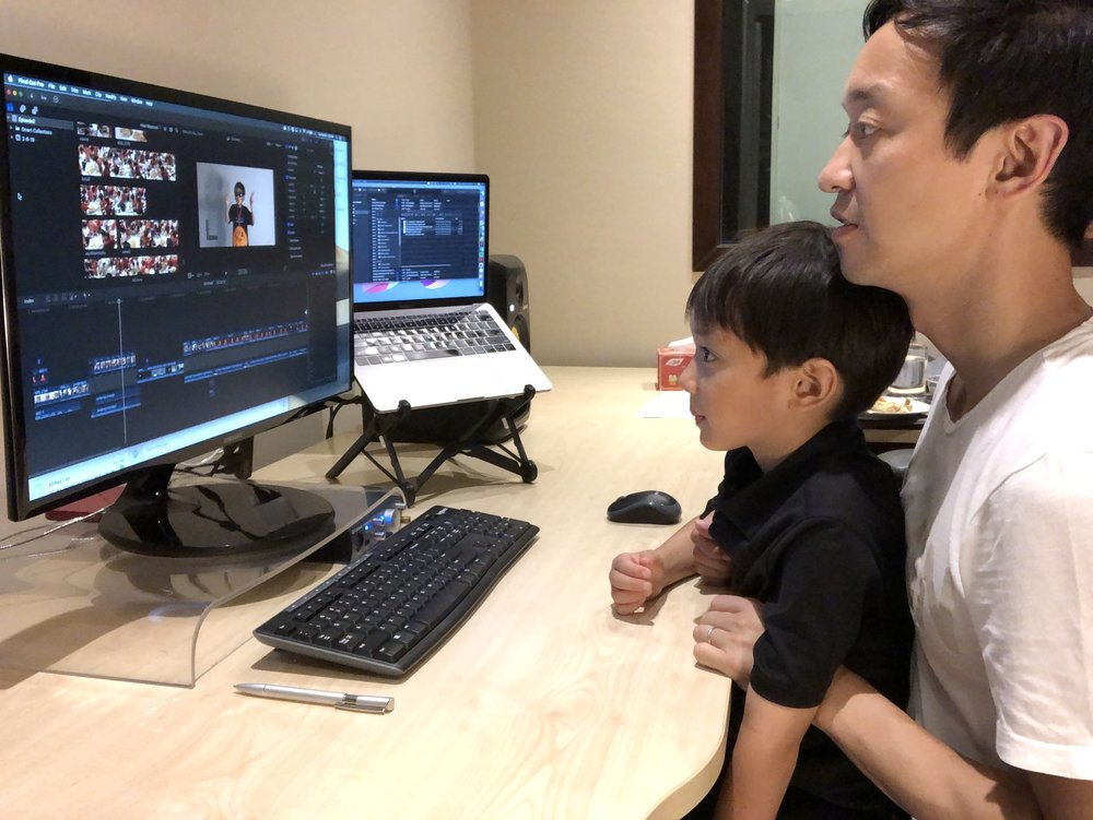 John Kim and his son working on a video project together (Image courtesy of John Kim)