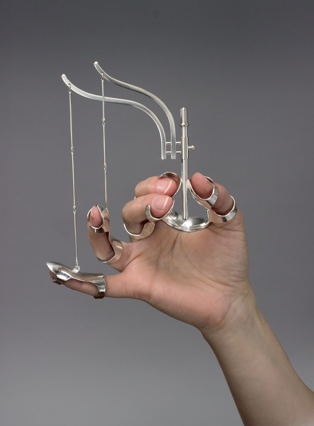 Ornamental Hands: Figure Four (shown worn) by Jennifer Crupi. Photo: Christian Luis.