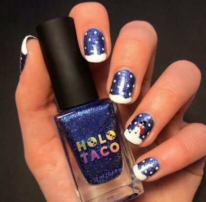 Image via  Instagram    Add a snowman (or woman!) to one nail on each hand for an extra fun manicure.