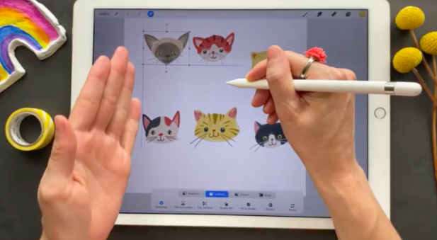 """As Brook Glaser lines up these cat faces, Procreate 5X generates guidelines and helps """"snap"""" them into place."""