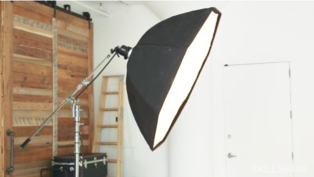 In the Skillshare class  Portrait Photography Essentials: One-Light Setups , instructor Justin Bridges demonstrates the use of an octobox, which is ideal for DIY photoshoot lighting.