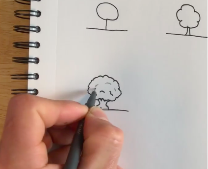 Outlining your work with a pen is the final step for this simple tree drawing!