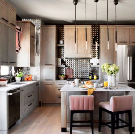 Pink barstools, a tin backsplash and contemporary lines make for a big impact in this kitchen design by Tiffany Brooks.