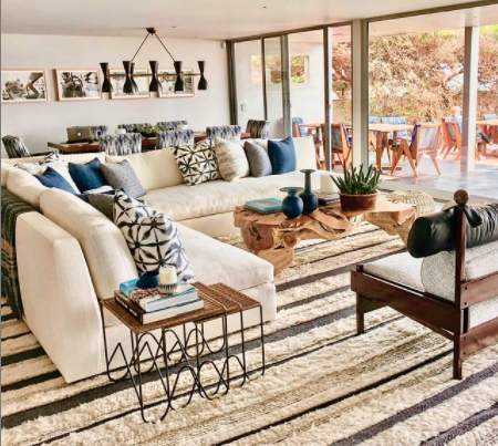 Mid-century furniture and cool blue accessories strike a beautiful balance here.