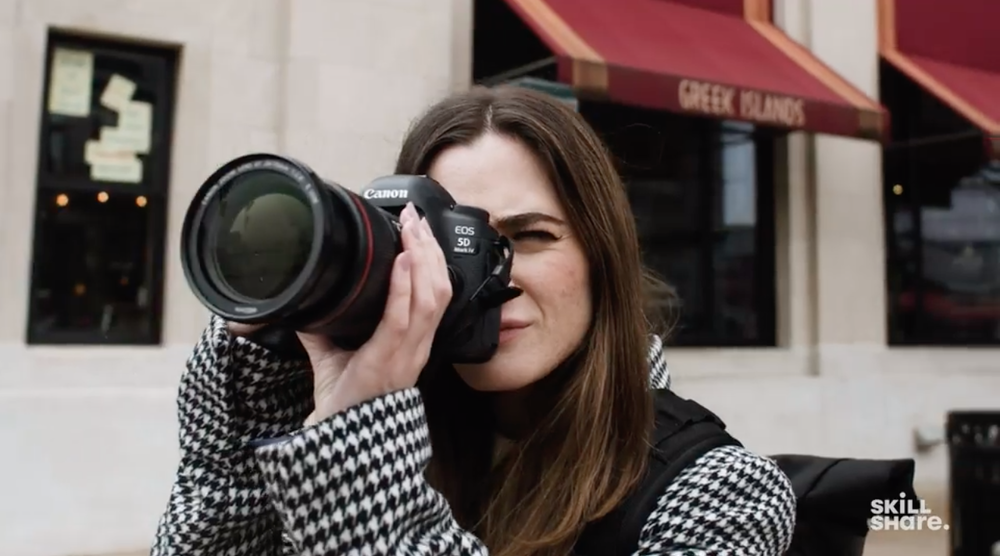 Skillshare instructor and photographer Jessica Kobeissi shoots a photo with her camera.