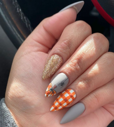 Image via  Instagram    Orange details can spice up an otherwise neutral fall manicure.