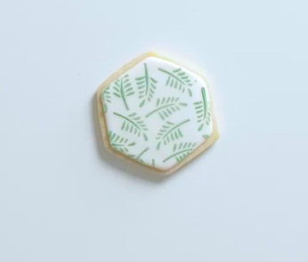 A stencil helped create these intricate, tropical leaves.