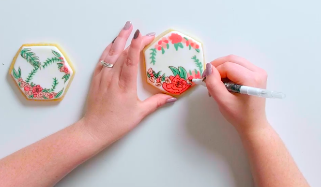 Edible markers add a fun, precise touch to cookie decoration.