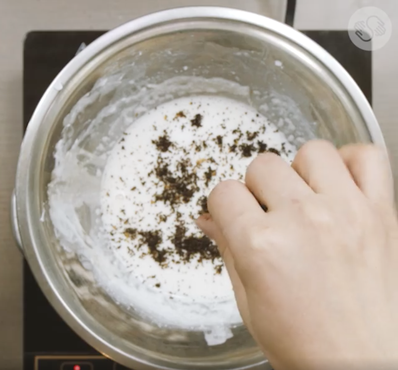 Soap mixture sprinkled with coffee grounds.