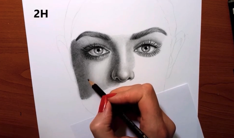 Adding darker shading on the side helps to mirror the shadow effect across that side of the face.