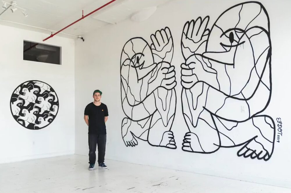 Illustrator and muralist Eric Friedensohn in front of his large scale work.