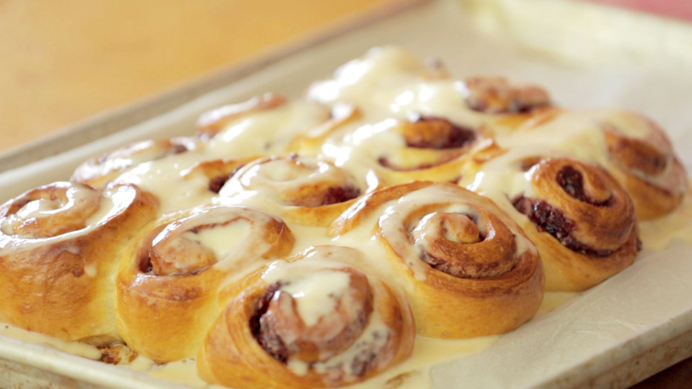 Julia Turshen's Raspberry Jam Buns with Creme Fraiche Frosting. Check out her Skillshare class for the full recipe!