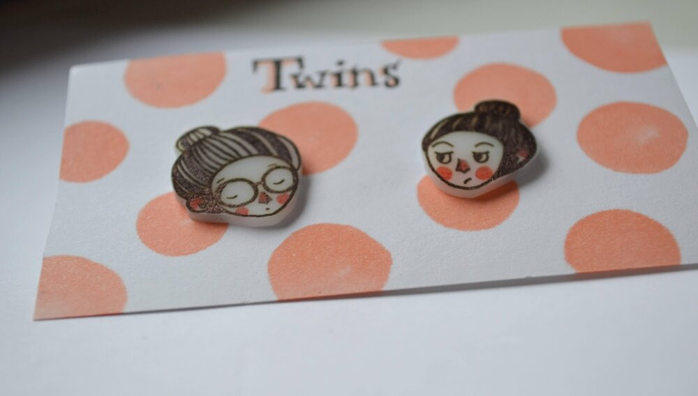Finished illustrated earrings ready to be worn.