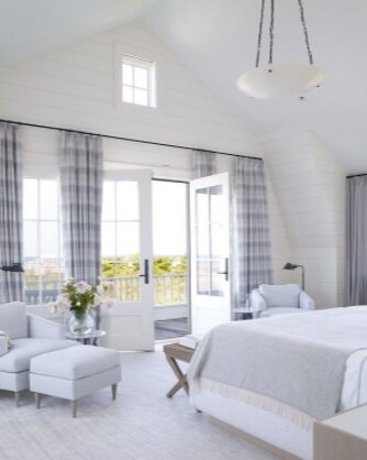 This clean, elegant bedroom will help you drift right off to sleep.