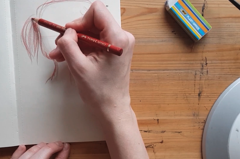 Adding in simple pencil strokes for the hair is the final step in finishing your drawing!