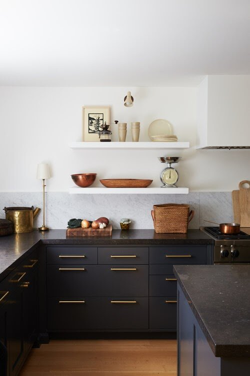 This minimalist kitchen design plays with light and dark colors.
