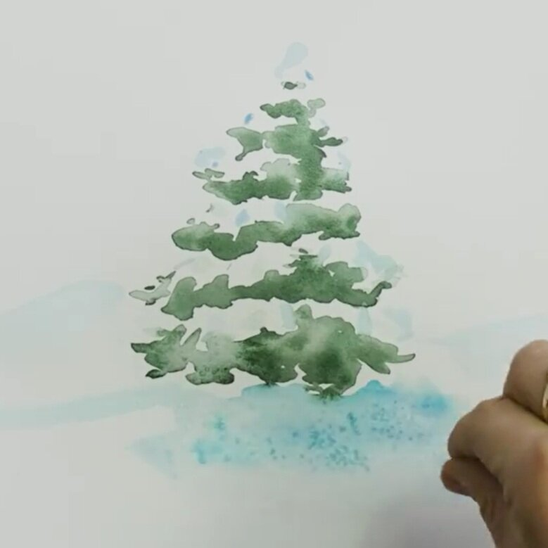 Sprinkle a pinch of salt onto the wet blue paint (snow) to create texture.